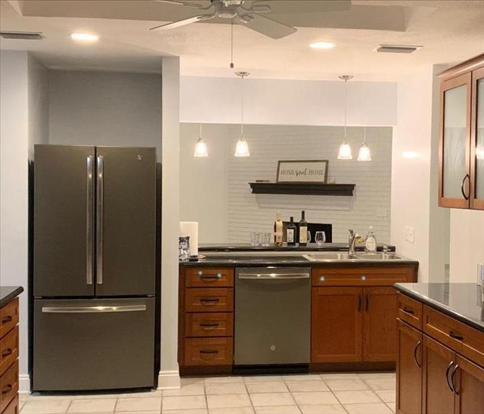 Updated Kitchen after Reconstruction showing new appliances and cabinets